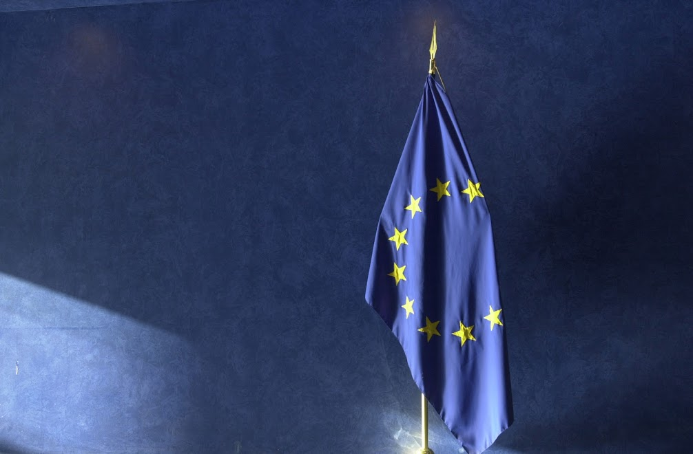 The national flag of Germany next to the European flag - Photographer: Mauro Bottaro